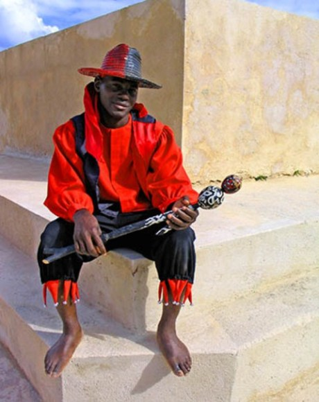eshu the trickster with his red and black hat